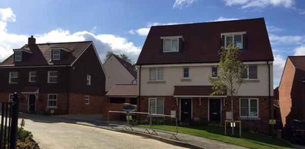 view of several residential propertieas re-roofed by kingsley roofing as part of a larger project for a main contractor