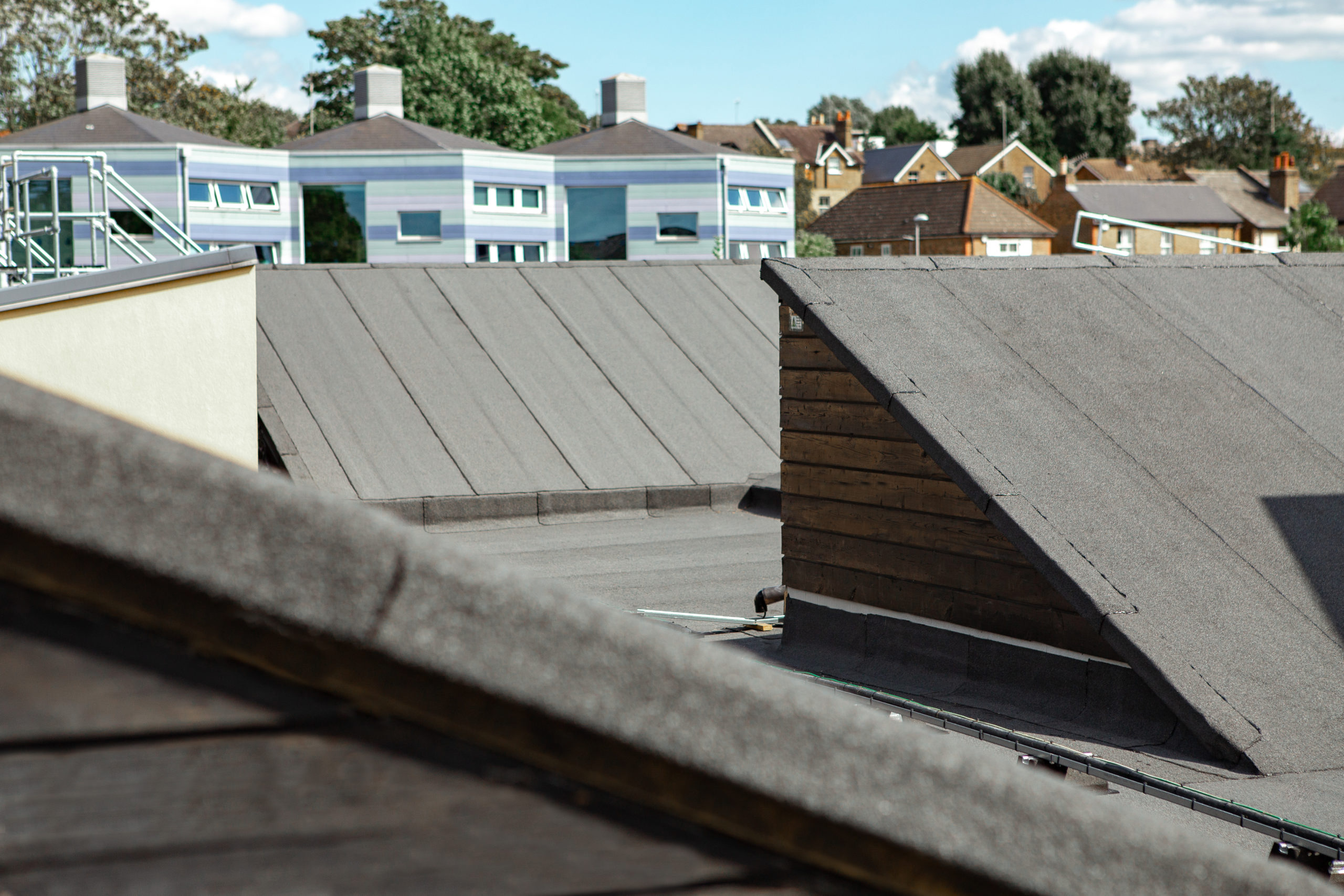 Felt roof with rooflight and cable runners and cladding
