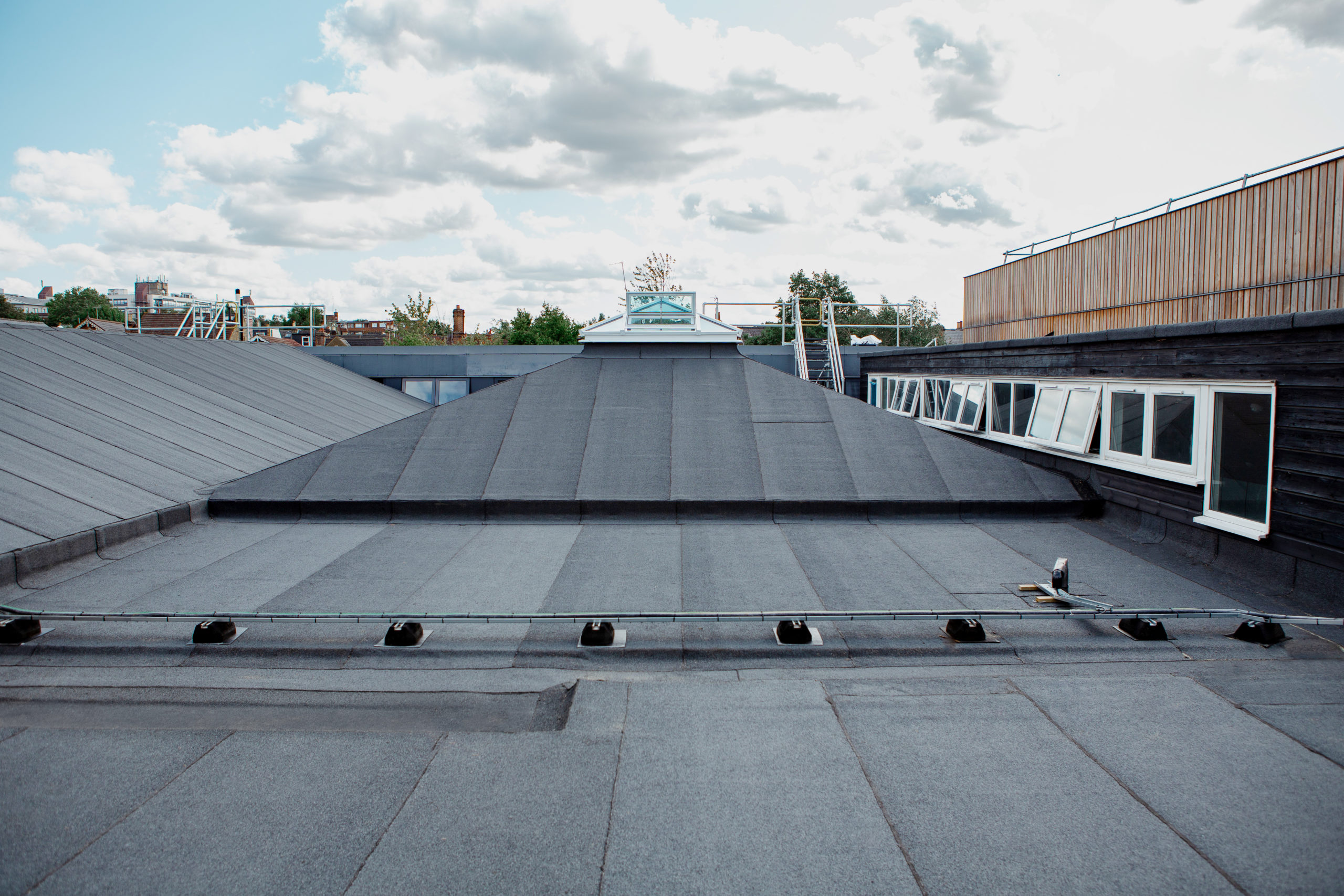 Felt roof with rooflight and cable runners